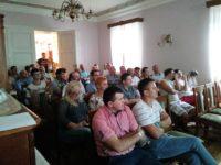 Zdjęcie przedstawiające ludzi na spotkaniu